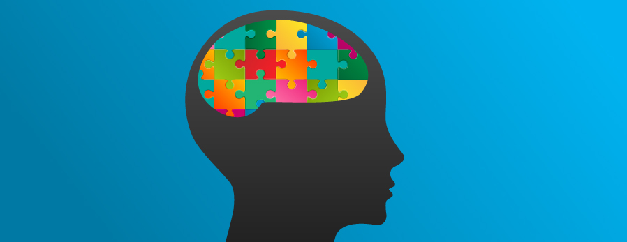 Illustration of a silhouette with a brain as a jigsaw puzzle